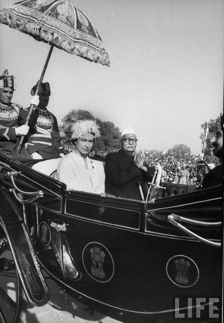 Queen Elizabeth II riding in carriage with Indian Pres. Rajendra Prasad during her state visit 1961